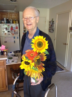 Dad at Solarbron with sunflowers cut from my garden.